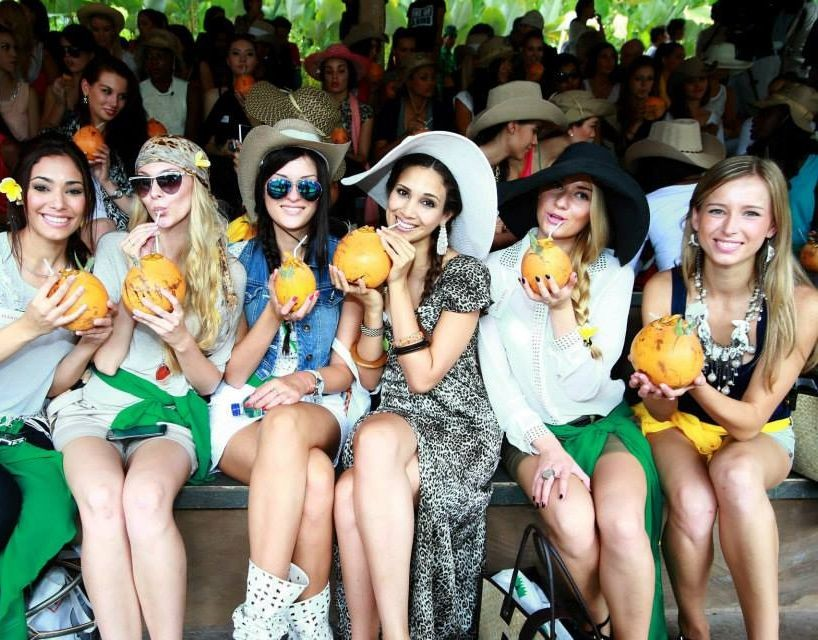 Miss World contestants enjoy a sip of coconut water at Bali Safari and Marine Park (Photo: Miss World Organisation)