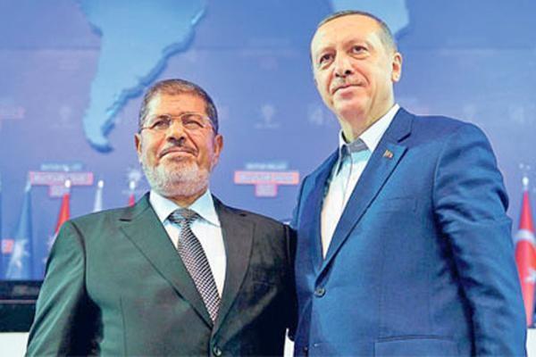 Recep Erdogan, right, with Mohamed Morsi