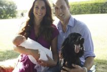 Prince William seen here with Kate, Prince George and their pet dog, cocker spaniel Lupo has swapped military life for family life