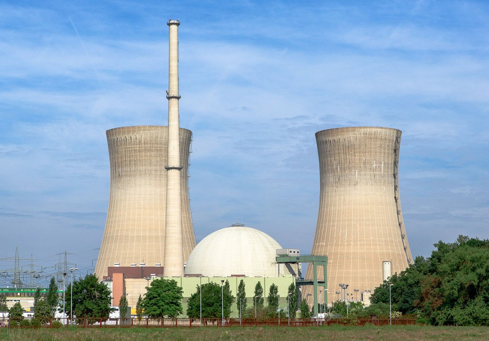 A nuclear power station. The nuclear reactor is contained inside the spherical containment building in the center - left and right are cooling towers which are common cooling devices used in all thermal power stations, and likewise, emit water vapor from