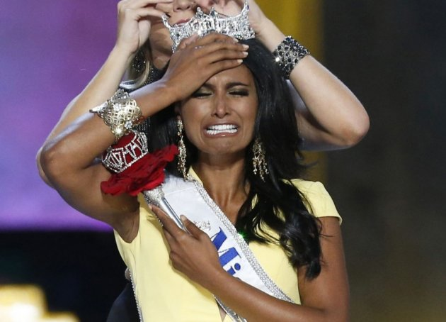 Miss America contestant, Miss New York Nina Davuluri reacts after being chosen winner of the 2014 Miss America Pageant as 2013 Miss America Mallory Hagan places a tiara on her head in Atlantic City, New Jersey, September 15, 2013. (REUTERS/Lucas Jackson)