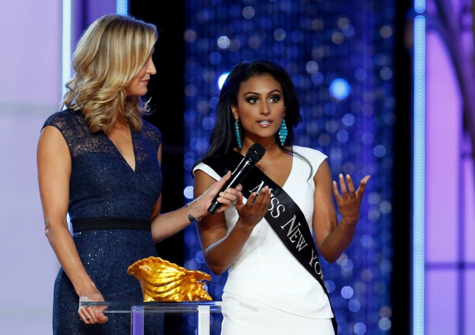 Miss New York Nina Davuluri (R) answers a question from host Lara Spencer during the 2014 Miss America Pageant. (REUTERS/Lucas Jackson)