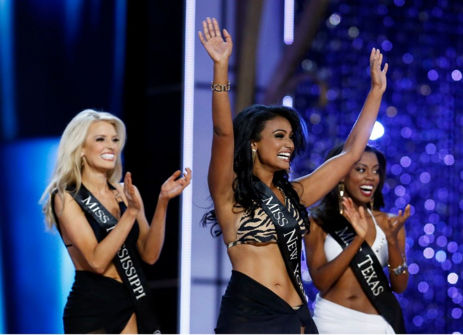 Nina Davuluri reacts as she is chosen to move on while competing in the Miss America Pageant. (REUTERS/Lucas Jackson)