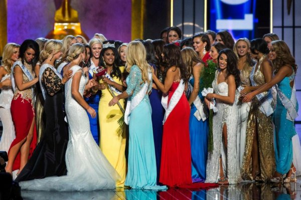 Nina Davuluri (in yellow) celebrates with other contestants after being crowned Miss America 2014. (REUTERS/Lucas Jackson)