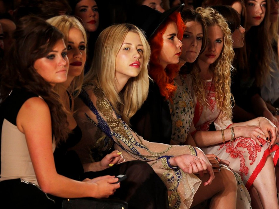 Singer Pixie Lott, Peaches Geldof, singer Paloma Faith, and actresses Anna Kendrick and MacKenzie Mauzy watch the presentation for the Temperley Spring/Summer 2014 collection. (REUTERS/Suzanne Plunkett)