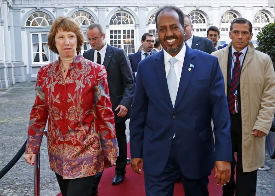 """European Union foreign policy chief Catherine Ashton (L) and Somali's President Hassan Sheikh Mohamud (R) arrive at a conference called """"New Deal in Somalia"""" in Brussels"""