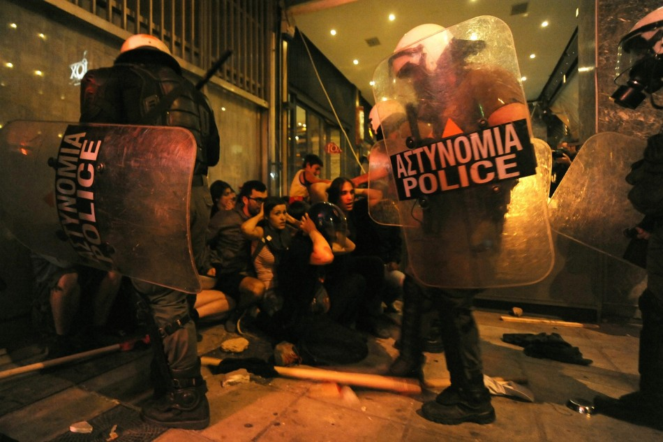 Riot police officers detain protesters after clashes in the northern Greek town of Thessaloniki between police and angry anti-fascist protesters