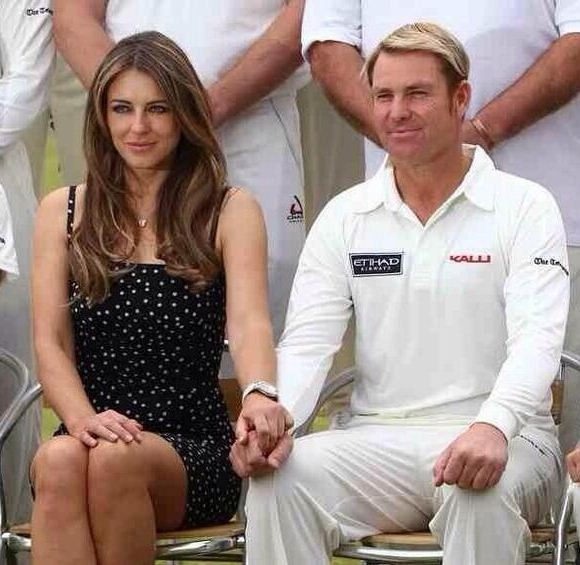 Elizabeth Hurley and  Shane Warne have taken to Twitter to address speculations about their relationship status/Twitter/ElizabethHurley