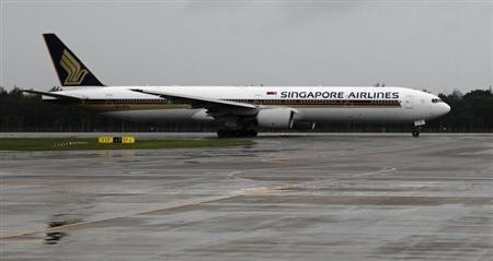 A Singapore Airlines Boeing 777-300 aircraft taxis on a runway at Changi airport on a rainy day in Singapore January 29, 2011.