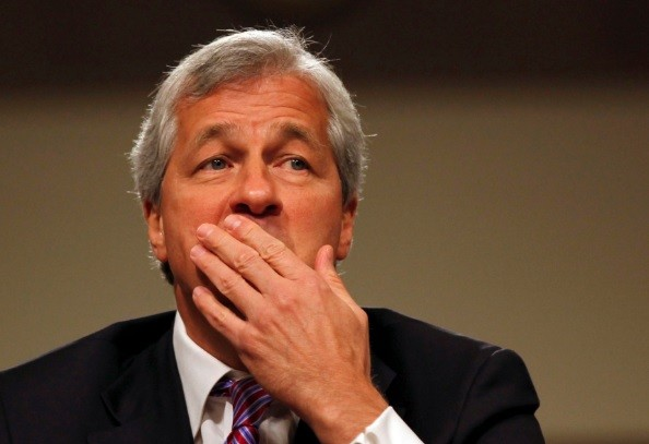 JPM led by Jamie Dimon (pictured) will have to pay $300m back to customers over debt collection procedures, which comes at the same time of the London Whale scandal $920m fine (Photo: Reuters)