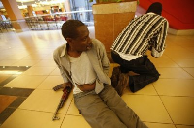 Wounded policeman and colleague, Westgate shopping mall, Nairobi