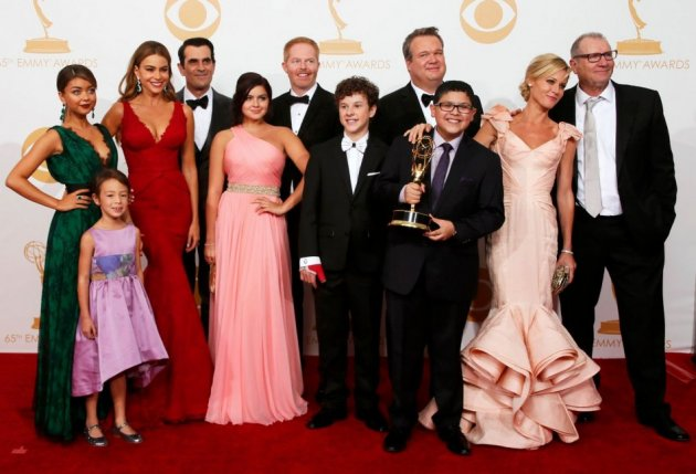 The cast of ABC's series Modern Family poses with their award for Outstanding Comedy Series at the 65th Primetime Emmy Awards in Los Angeles. (Reuters)
