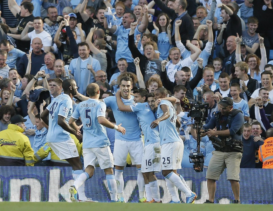 Manchester City Players Celebrate After Scoring