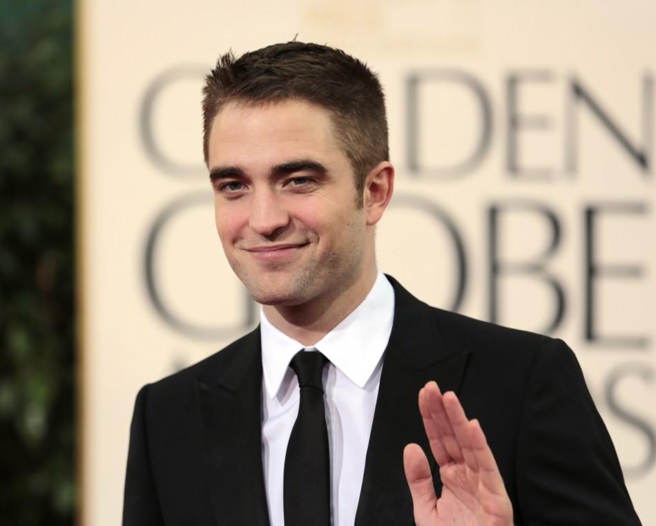 Robert Pattinson Debuts New Brunette Girlfriend/Reuters