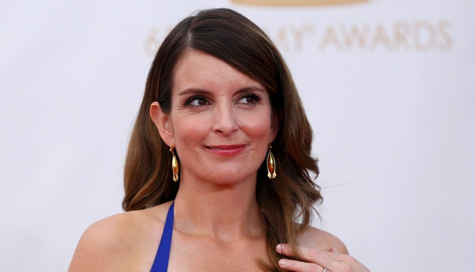 Tina Fey accidentally flashed her breast when she went to accept her Best Comedy Writing award. (Reuters)