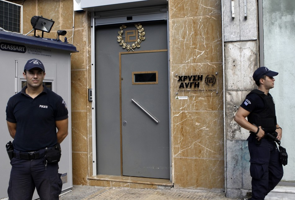 Police stand guard outside the Golden Dawn office in Athens.