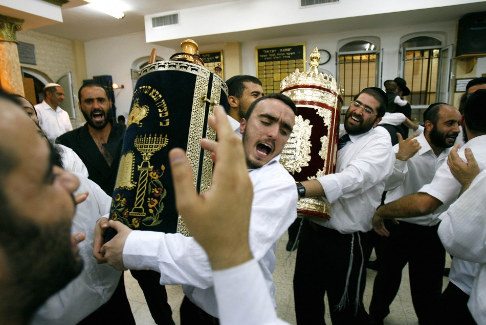 Ultra-Orthodox Jews dance with the Scroll of the Torah during the Jewish holiday of Simchat Torah at a synagogue in the Mea Shearim neighborhood of Jerusalem