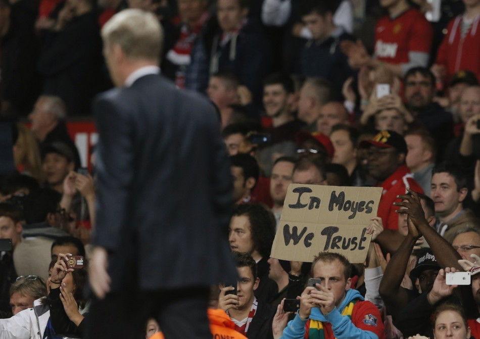 Manchester United fan with In Moyes We Trust Placard