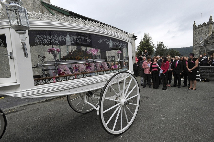 The coffin of April Jones is carried by a horse-drawn carriage following her funeral service at St Peter's Church in Machynlleth PIC: Reuters