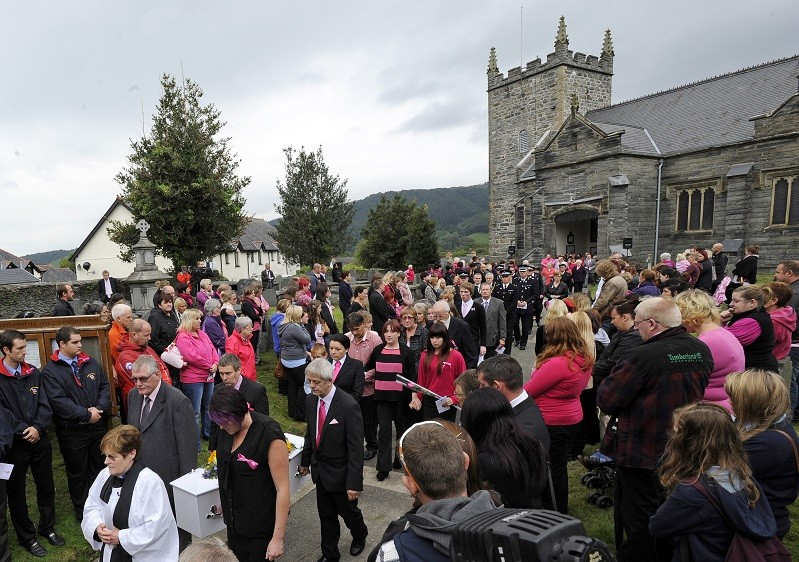 The coffin of April Jones is carried from St Peter's Church after her funeral service in Machynlleth PIC: Reuters
