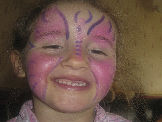 Murdered April Jones wearing face paint in her favourite colour, pink