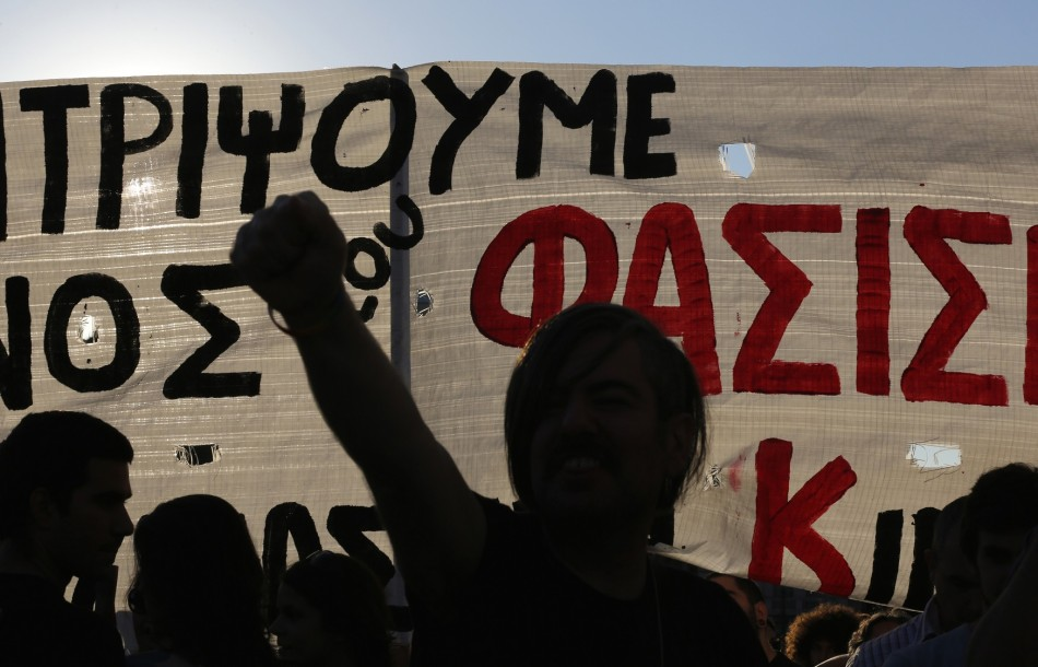 A protester raises his fist on a demonstration against the far-right Golden dawn organisation in Athens last night.