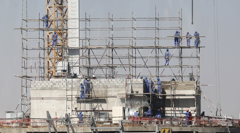 Labourers toil on construction site in searing heat and not all are paid, it was alleged PIC: Reuters