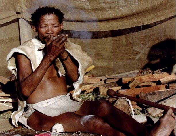 Bushman Petrus Kruiper, 76, dressed in animal skins, smokes as he is exhibited like a zoo animal at the annual fair in this town about 110 km west of Johannesburg. A tribal people's organisation has urged holidaymakers to boycott Botswana for the ill trea