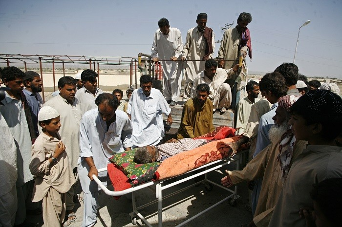 Survivors of the earthquake are taken to hospital in Awaran, southwestern Pakistani province of Baluchistan.