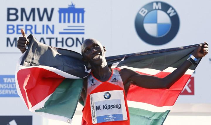Wilson Kipsang of Kenya celebrates with the Kenyan national flag after winning in the 40th Berlin marathon.
