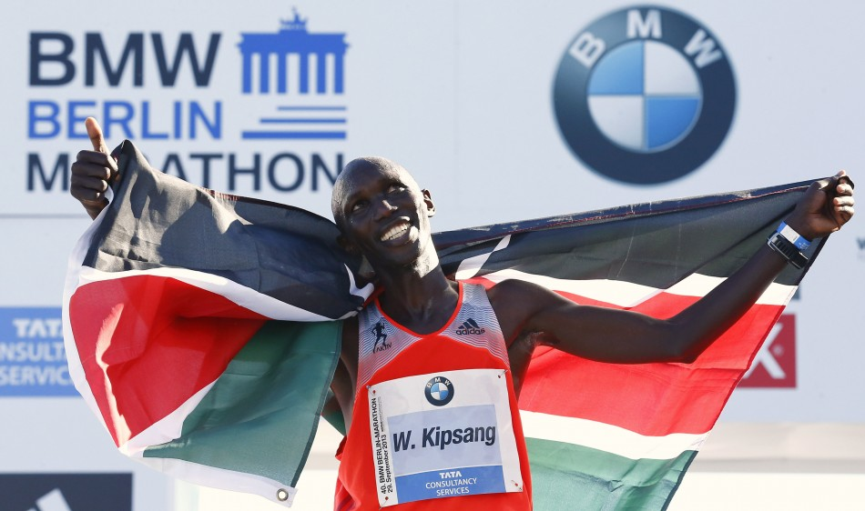 Wilson Kipsang of Kenya celebrates with the Kenyan national flag after winning in the 40th Berlin marathon.