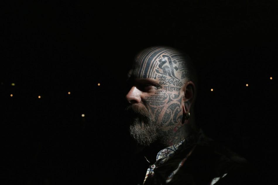 Tattoo artist Matt Black displays tattoos on his head.