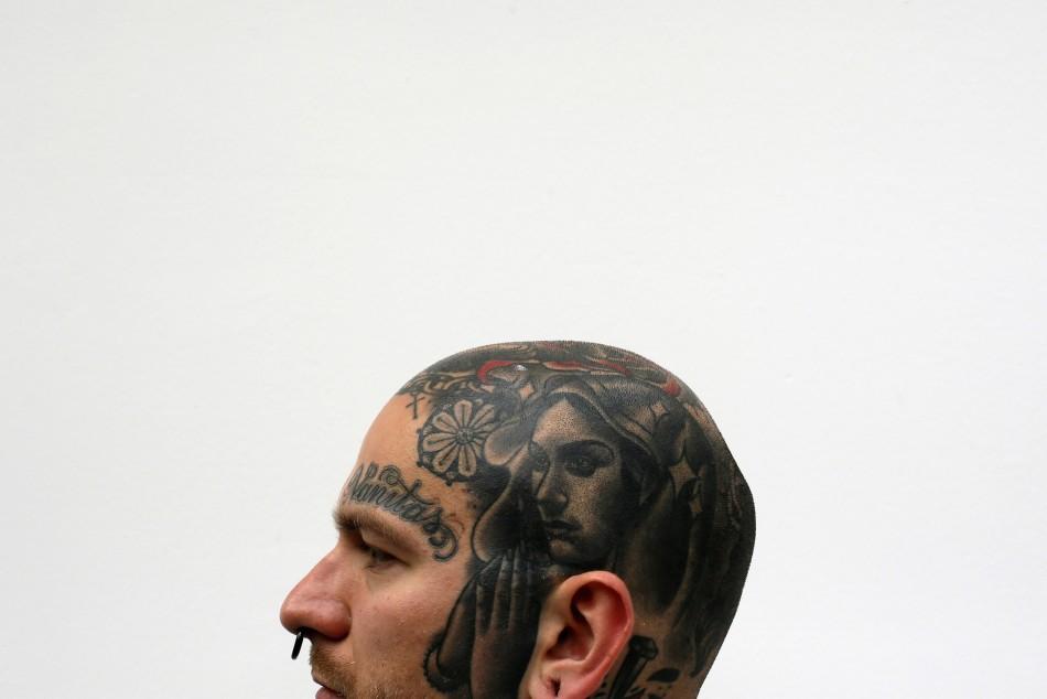 Religious symbolism in tattoos is still a popular motif.