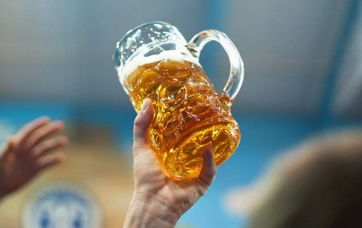 A visitor raises a toast with a beer mug at the 180th Oktoberfest in Munich, Germany. (Photo: Oktoberfest.de/Facebook)
