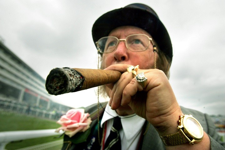 John McCririck was famous for his signature flamboyant style on Channel 4 PIC: Reuters