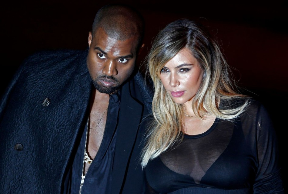 US musician Kanye West and companion Kim Kardashian arrive at the Givenchy Spring/Summer 2014 women's ready-to-wear fashion show during Paris Fashion Week September 29, 2013. (Photo: REUTERS/Charles Platiau)