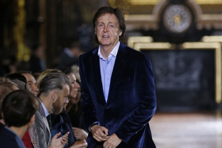 Singer Paul McCartney attends the Spring/Summer 2014 women's ready-to-wear fashion show designed by his daughter British designer Stella McCartney. (Photo: REUTERS/Benoit Tessier)