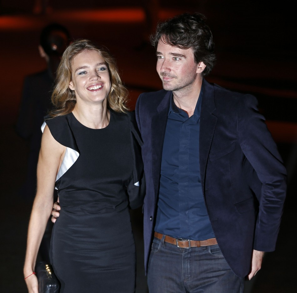 Antoine Arnault (R), member of LVMH group's board of directors and head of communications for Louis Vuitton, and girlfriend, Russian model Natalia Vodianova arrive at the Givenchy Spring/Summer 2014 women's ready-to-wear fashion show during Paris Fashion