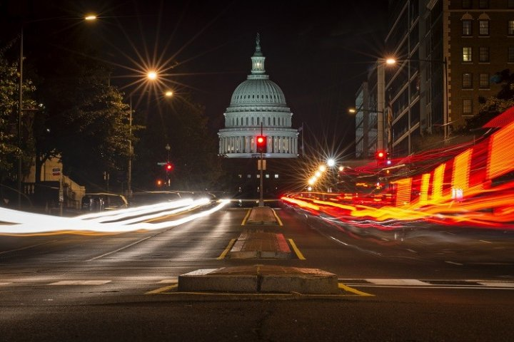 A red traffic light stands in front of the U.S. Capitol building. the US government partially shut down after a midnight deadline to approve a budget for 2014 passed despite an eleventh-hour appeal by President Barack Obama. (Photo: Reuters)