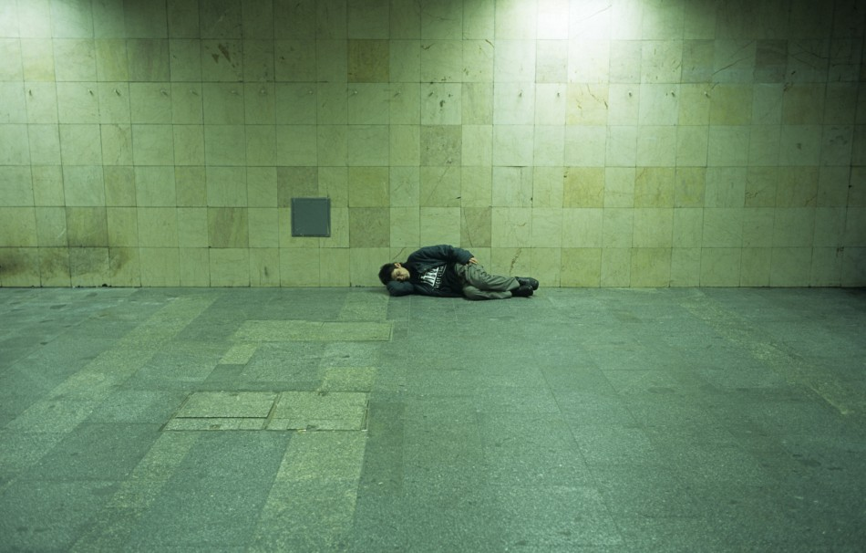 A homeless man sleeps on a platform in Budapest PIC: Reuters