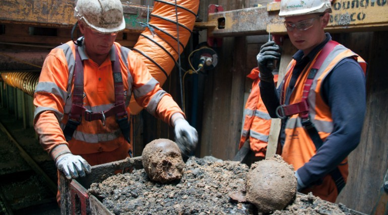Archaeologists show the skulls found at Liverpool. (Photo: ©Crossrail Ltd 2013)