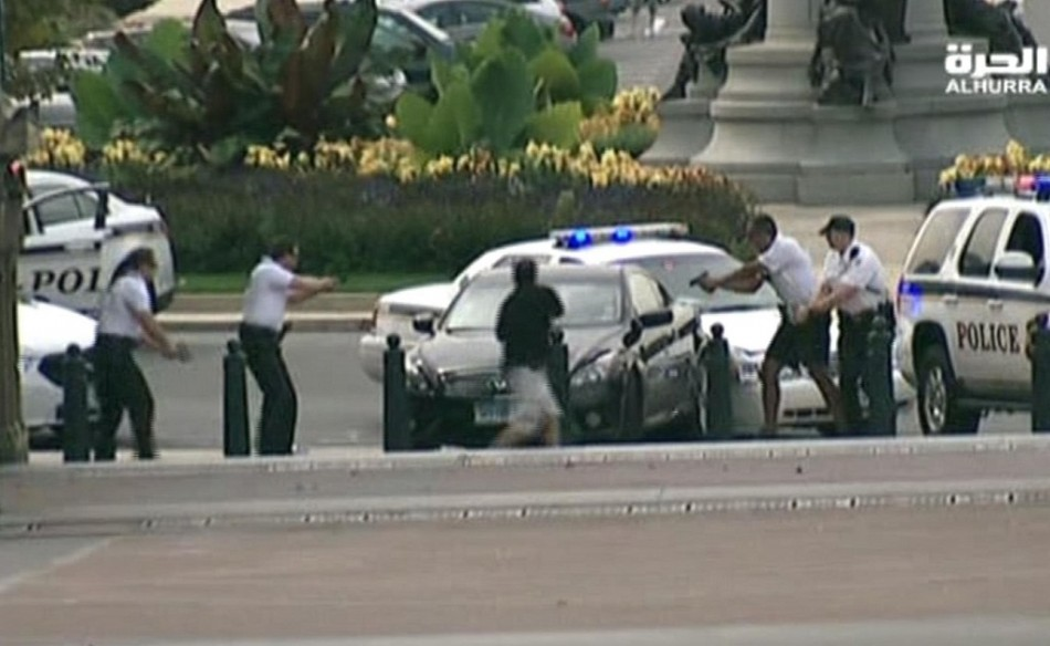 Black sedan is surrounded by officers with guns drawn near the White House PIC: Reuters