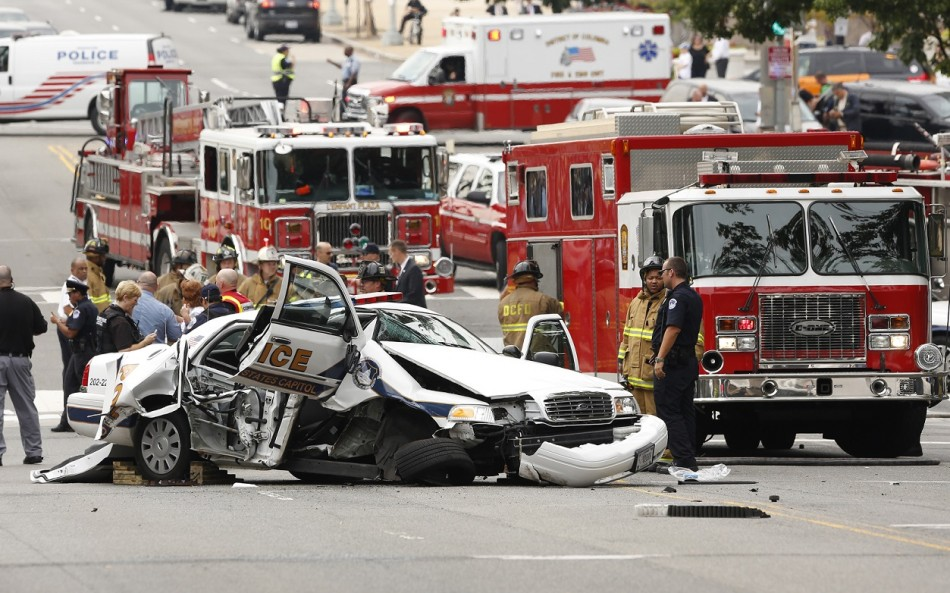 Wrecked police car in Washington police chase PIC: Reuters