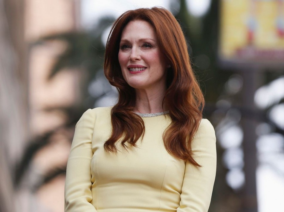 Actress Julianne Moore waits before unveiling her star on the Walk of Fame in Hollywood, California October 3, 2013. (Photo: REUTERS/Mario Anzuoni)