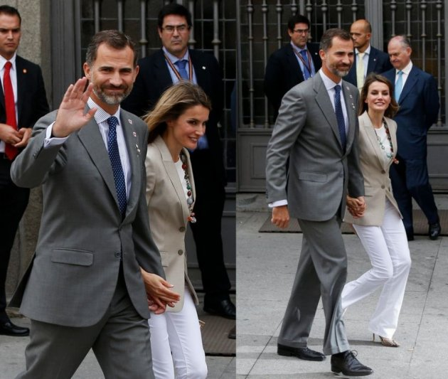 Princess Letizia and her husband, Spain's Crown Prince Felipe, walk away after she collected money donations for the Spanish Red Cross during