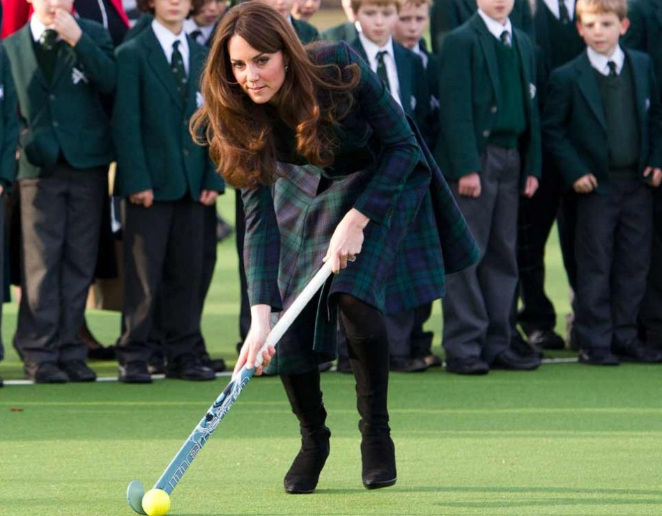 Kate Middleton joins children for a game of hockey during a visit to her old school in Pangbourne, Berkshire, in November 2012. (Photo: Clarence House)