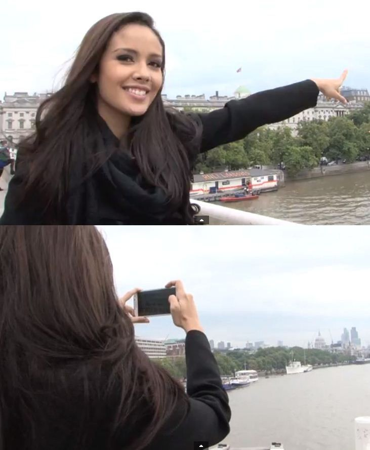 Megan Young points towards cathedral from Thames; she took a picture of it for the Miss World's Diary. (Photo: YouTube Video Screenshot/Miss World Organisation)