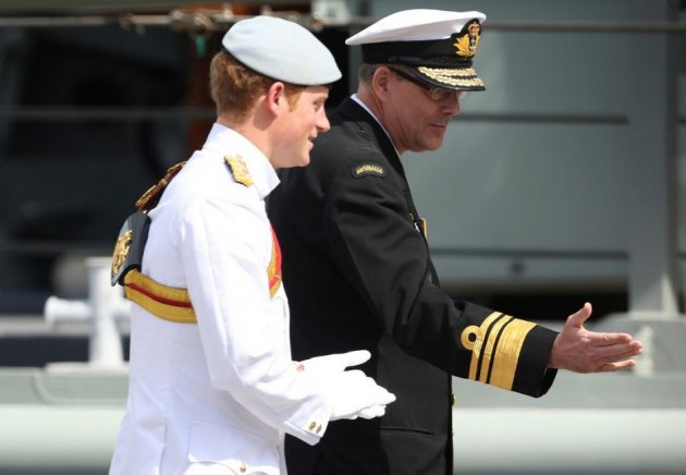 Prince Harry walks with Rear Admiral Ray Griggs before saluting te troops at Garden Island during International Fleet Review in Sydney. (Photo: REUTERS)