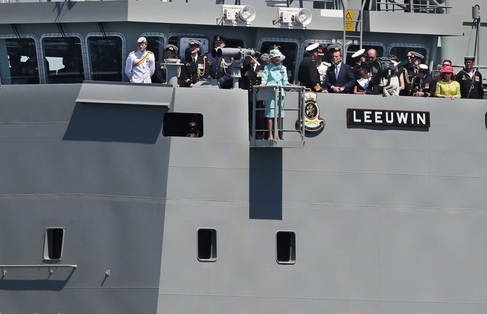 Prince Harry and Australia's Governor-General Quentin Bryce salute the troops on Sydney Harbour from aboard the HMAS Leeuwin. (Photo: REUTERS)