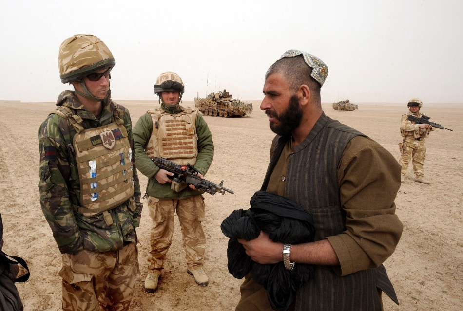 Prince Harry talks with local man at checkpoint during tour of duty in Afghanistan PIC: Reuters